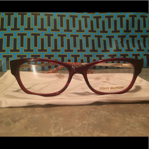 d7c6f6605278 Tory Burch Cranberry Ladies Square Eyeglasses. M_5ae81a38d39ca21ab23d25ad